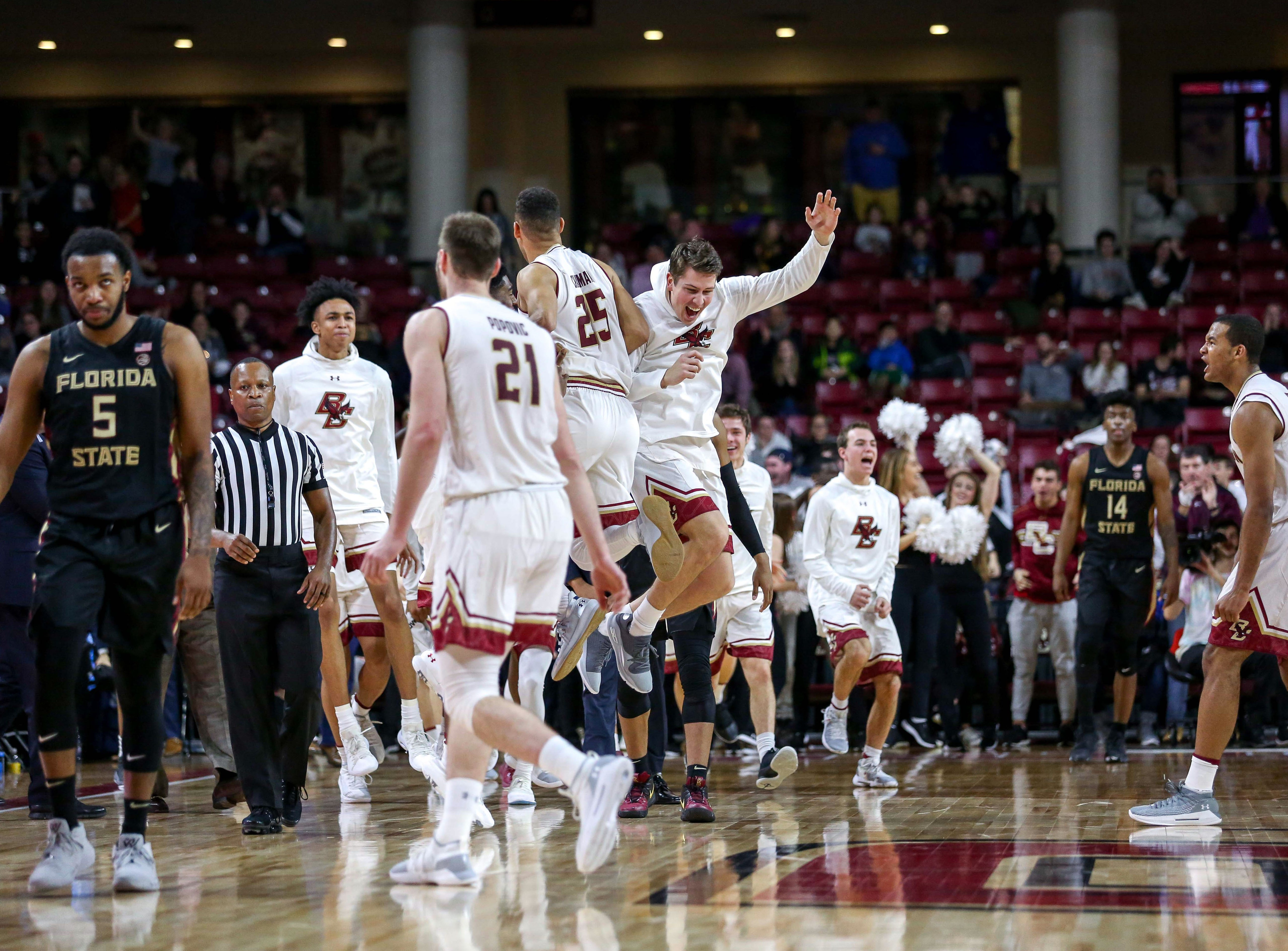 Jan 20, 2019; Chestnut Hill, MA, USA; Boston College Eagles guard Jordan Chatman (25) reacts with the Boston College Eagles bench after hitting a three pointer against the Florida State Seminoles during the second half at Conte Forum. Mandatory Credit: Paul Rutherford-USA TODAY Sports