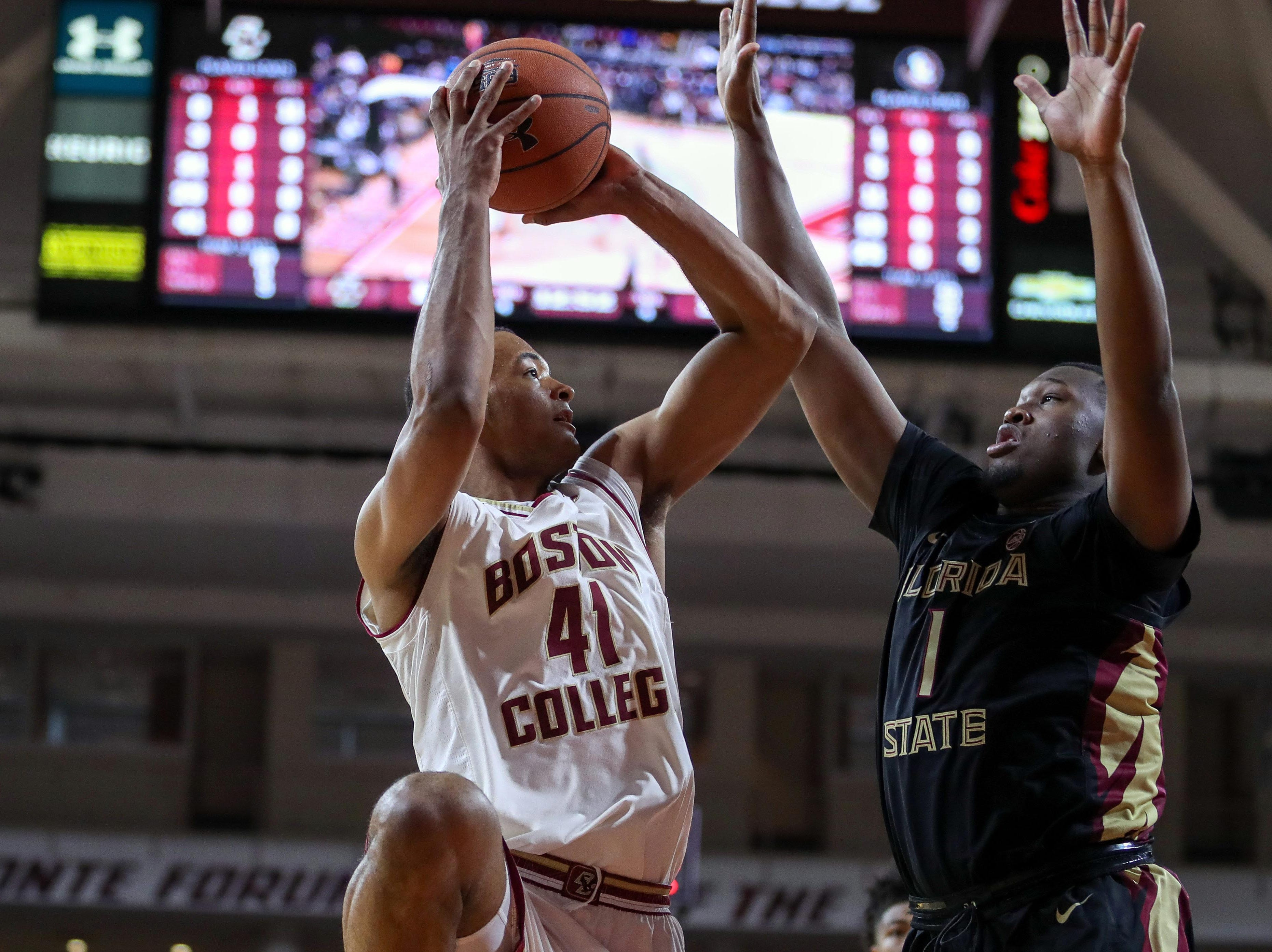 Jan 20, 2019; Chestnut Hill, MA, USA; Boston College Eagles forward Steffon Mitchell (41) shoots against Florida State Seminoles forward Raiquan Gray (1) during the first half at Conte Forum. Mandatory Credit: Paul Rutherford-USA TODAY Sports