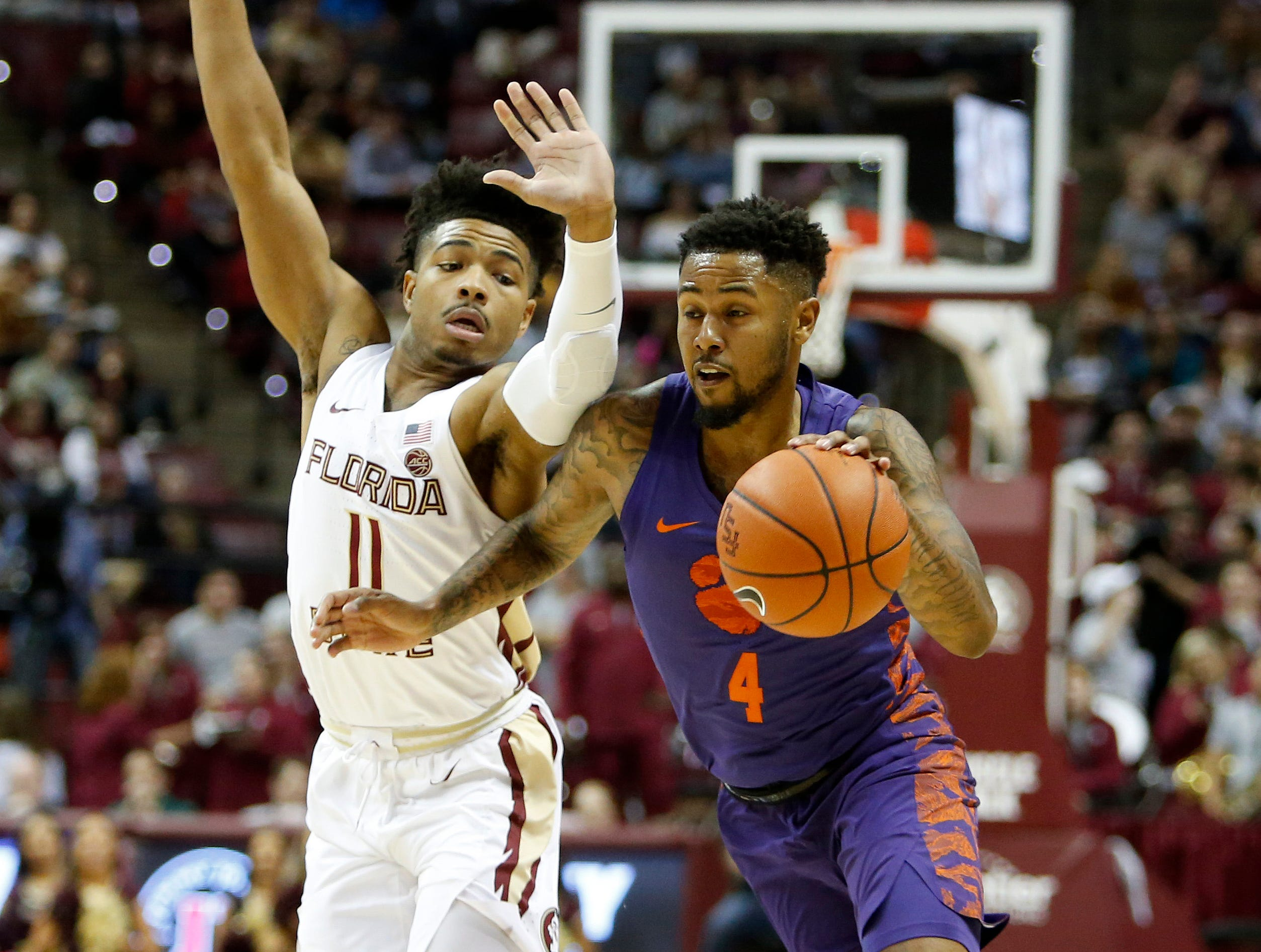 Jan 22, 2019; Tallahassee, FL, USA; Clemson Tigers guard Shelton Mitchell (4) drives against Florida State Seminoles guard David Nichols (11) during the first half at Donald L. Tucker Center. Mandatory Credit: Glenn Beil-USA TODAY Sports