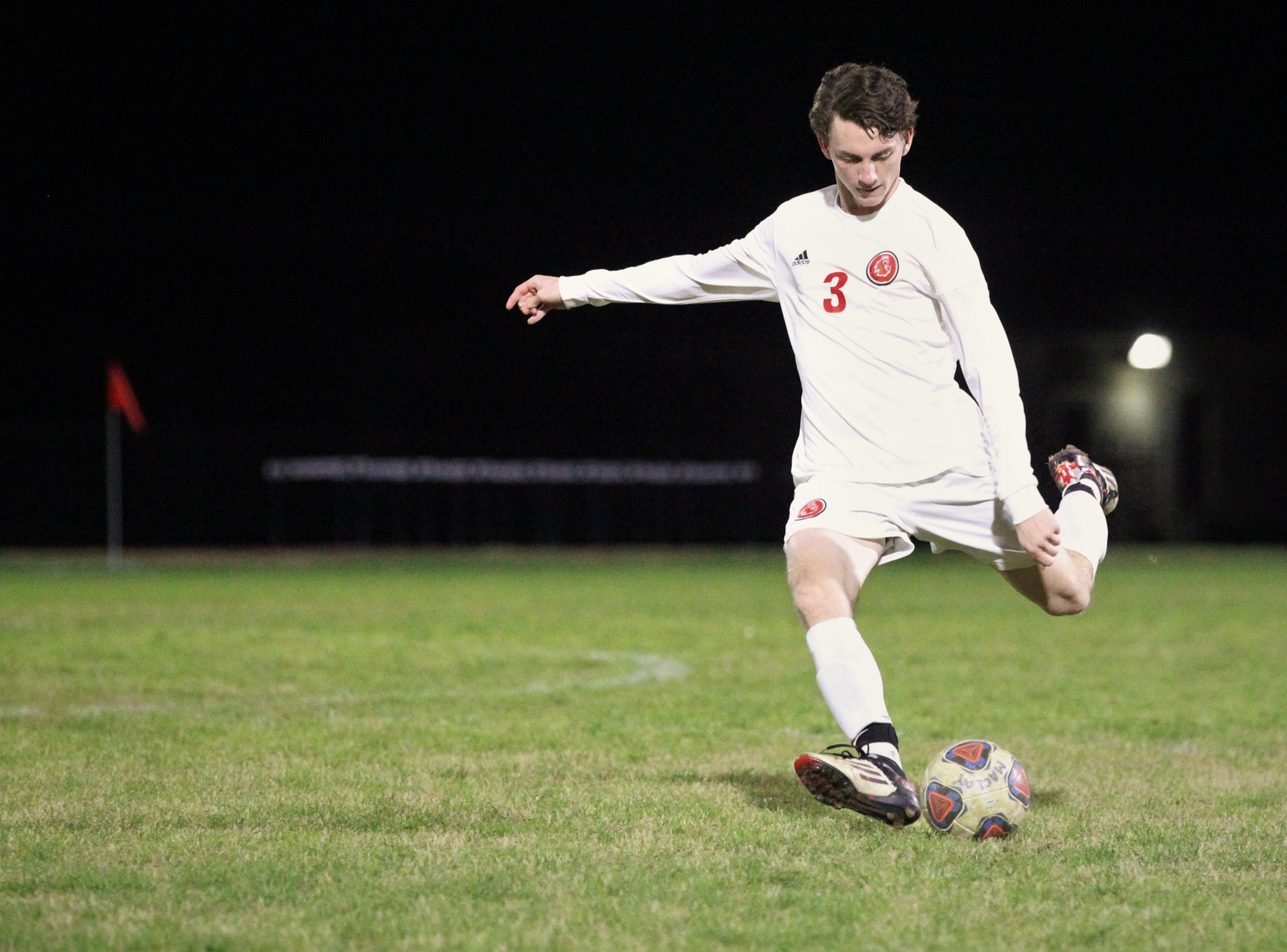 Leon's Tanner Powell sends a free kick into the box as Leon's boys soccer team beat Maclay 3-1 on Jan. 22, 2019.
