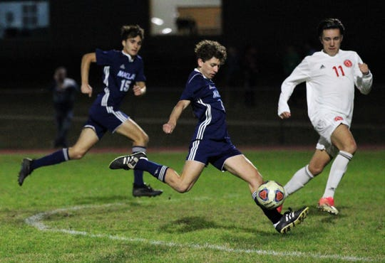 Maclay sophomore Drew Daunt times up a bouncing ball for a shot and a goal, but Leon's boys soccer team beat Maclay 3-1 on Jan. 22, 2019.