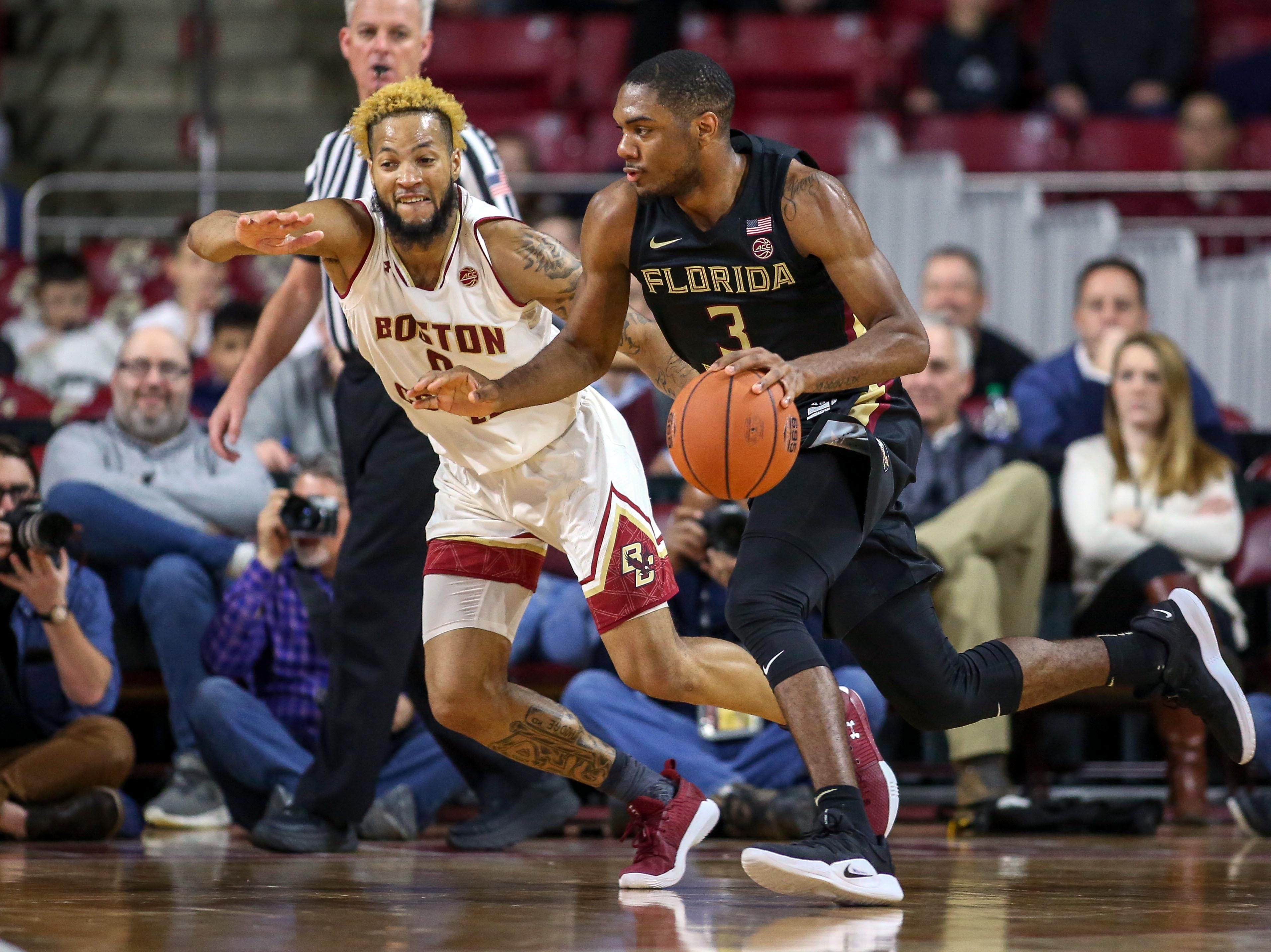 Jan 20, 2019; Chestnut Hill, MA, USA; Florida State Seminoles guard Trent Forrest (3) is defended by Boston College Eagles guard Ky Bowman (0) during the first half at Conte Forum. Mandatory Credit: Paul Rutherford-USA TODAY Sports