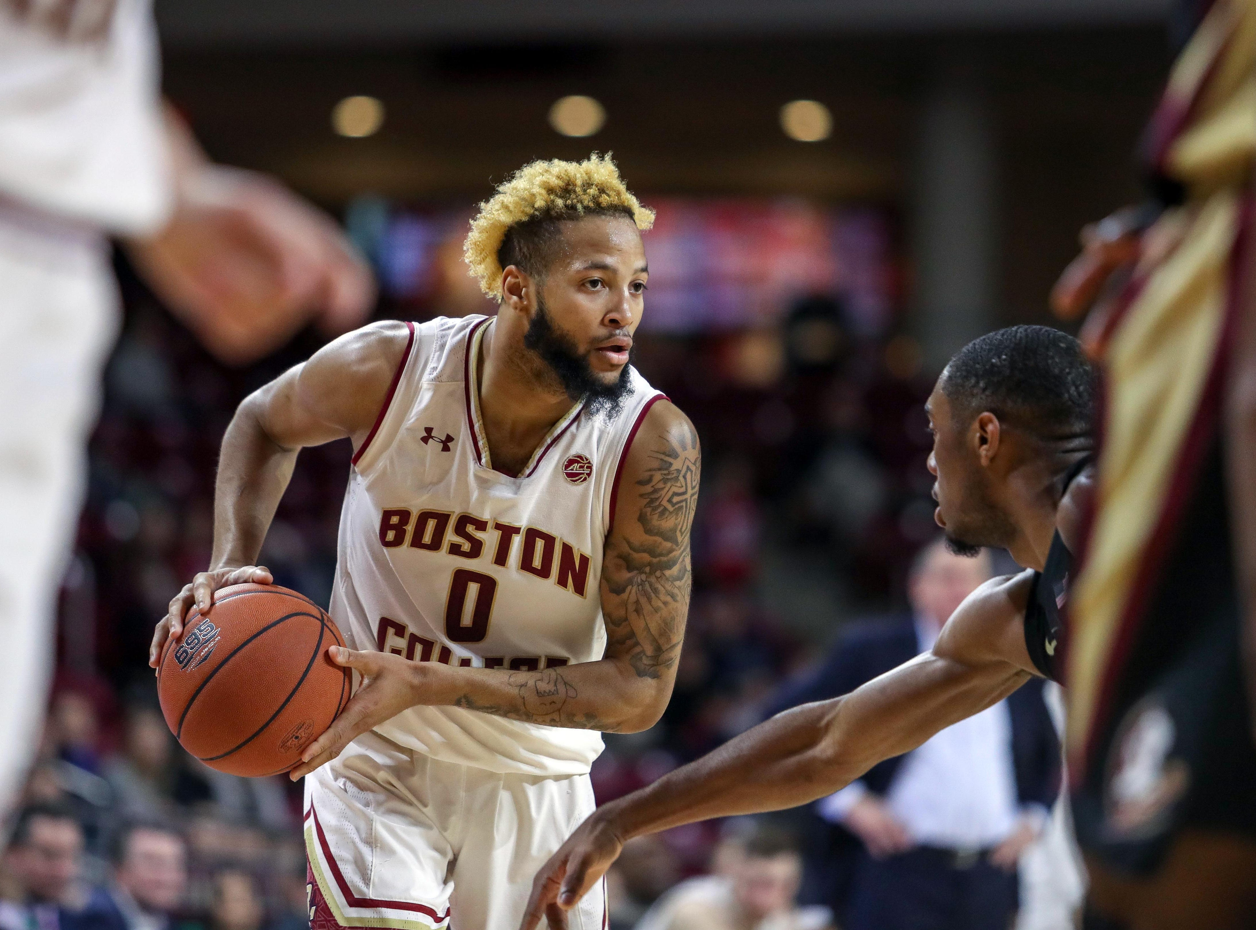 Jan 20, 2019; Chestnut Hill, MA, USA; Boston College Eagles guard Ky Bowman (0) looks to pass against the Florida State Seminoles during the first half at Conte Forum. Mandatory Credit: Paul Rutherford-USA TODAY Sports