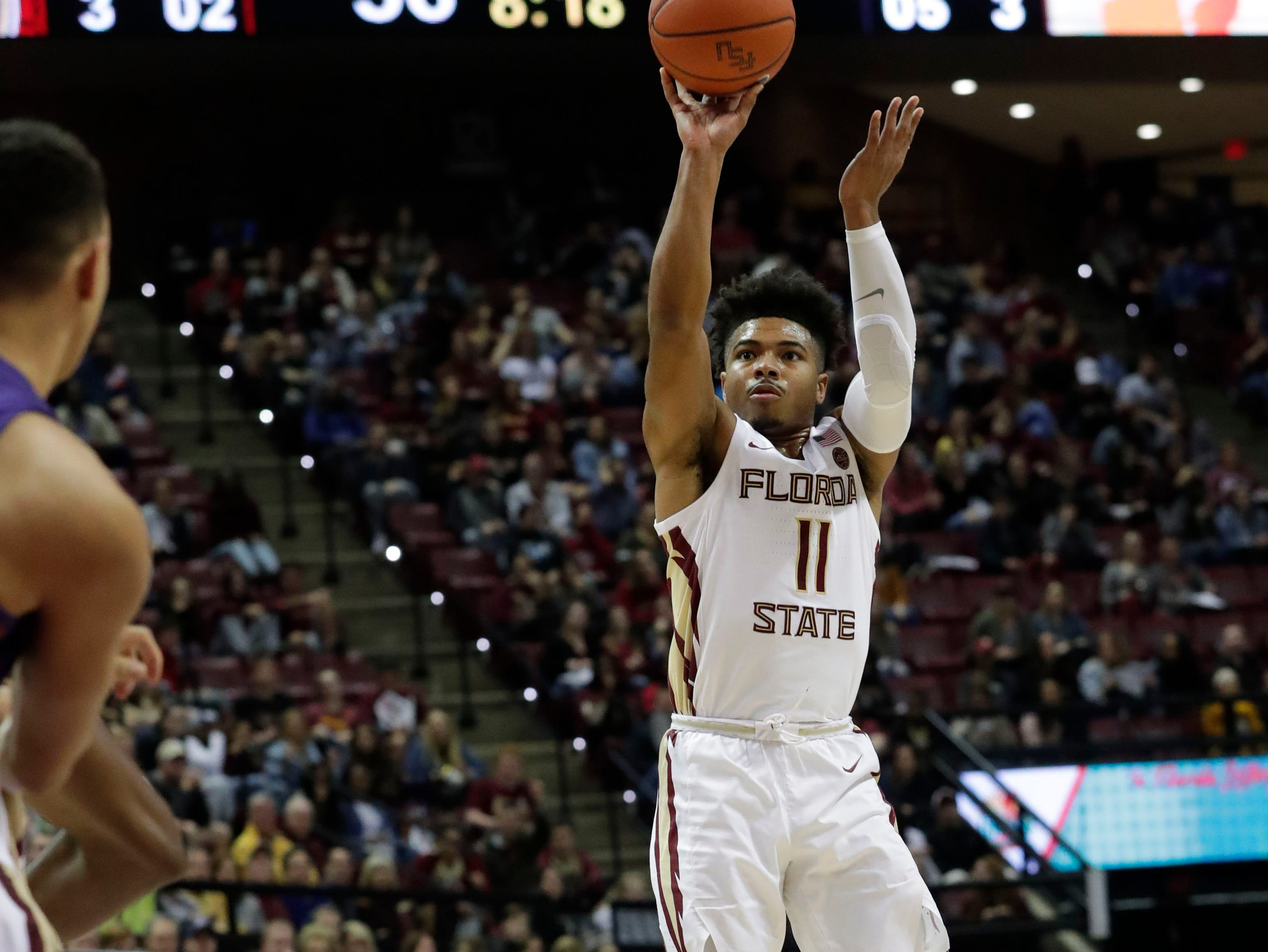 Florida State Seminoles guard David Nichols (11) shoots for two. The Florida State Seminoles face off against the Clemson Tigers at the Tucker Civic Center, Tuesday, Jan. 22, 2019.