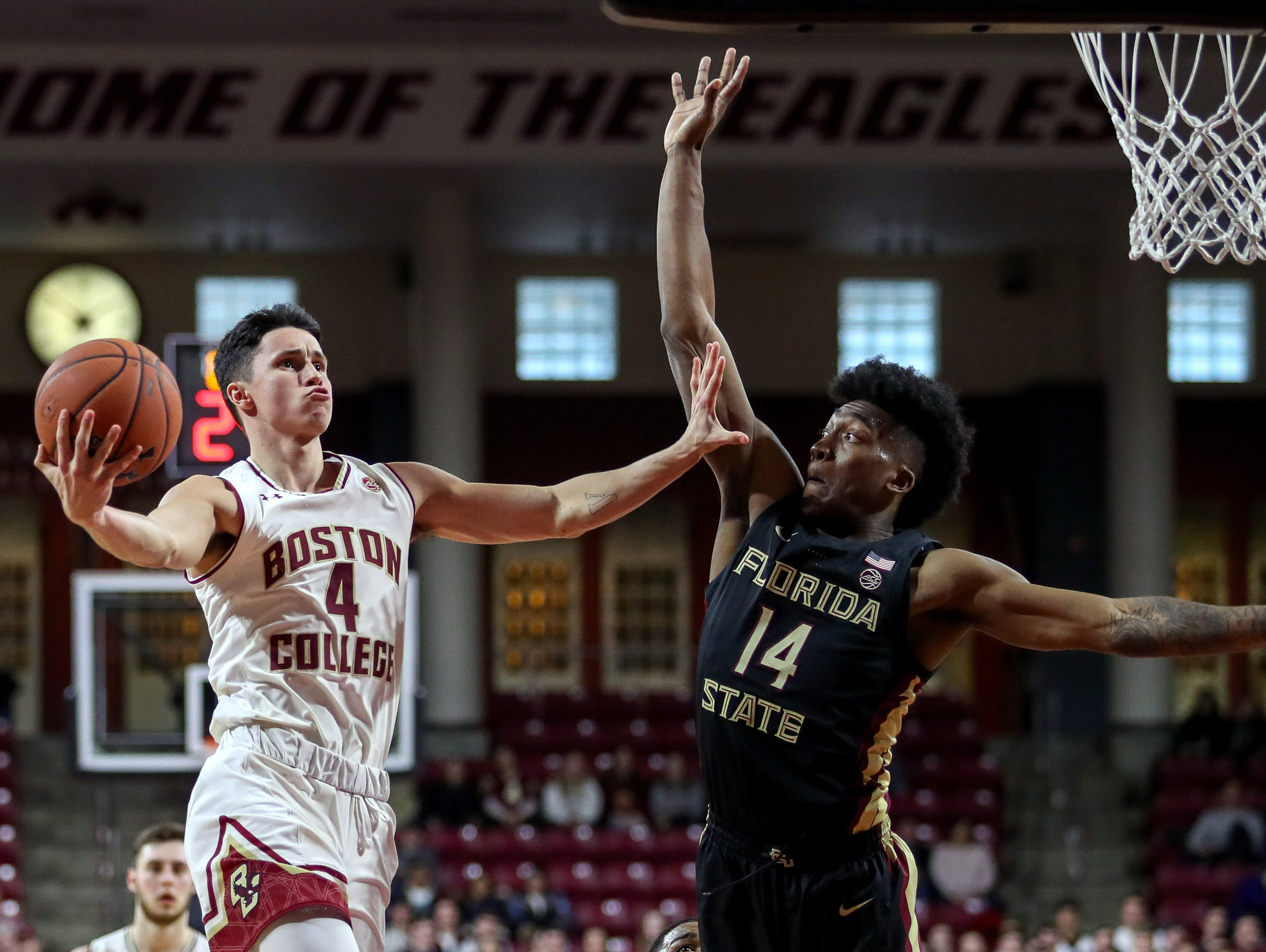 Jan 20, 2019; Chestnut Hill, MA, USA; Boston College Eagles guard Chris Herren Jr. (4) shoots against Florida State Seminoles guard Terance Mann (14) during the second half at Conte Forum. Mandatory Credit: Paul Rutherford-USA TODAY Sports