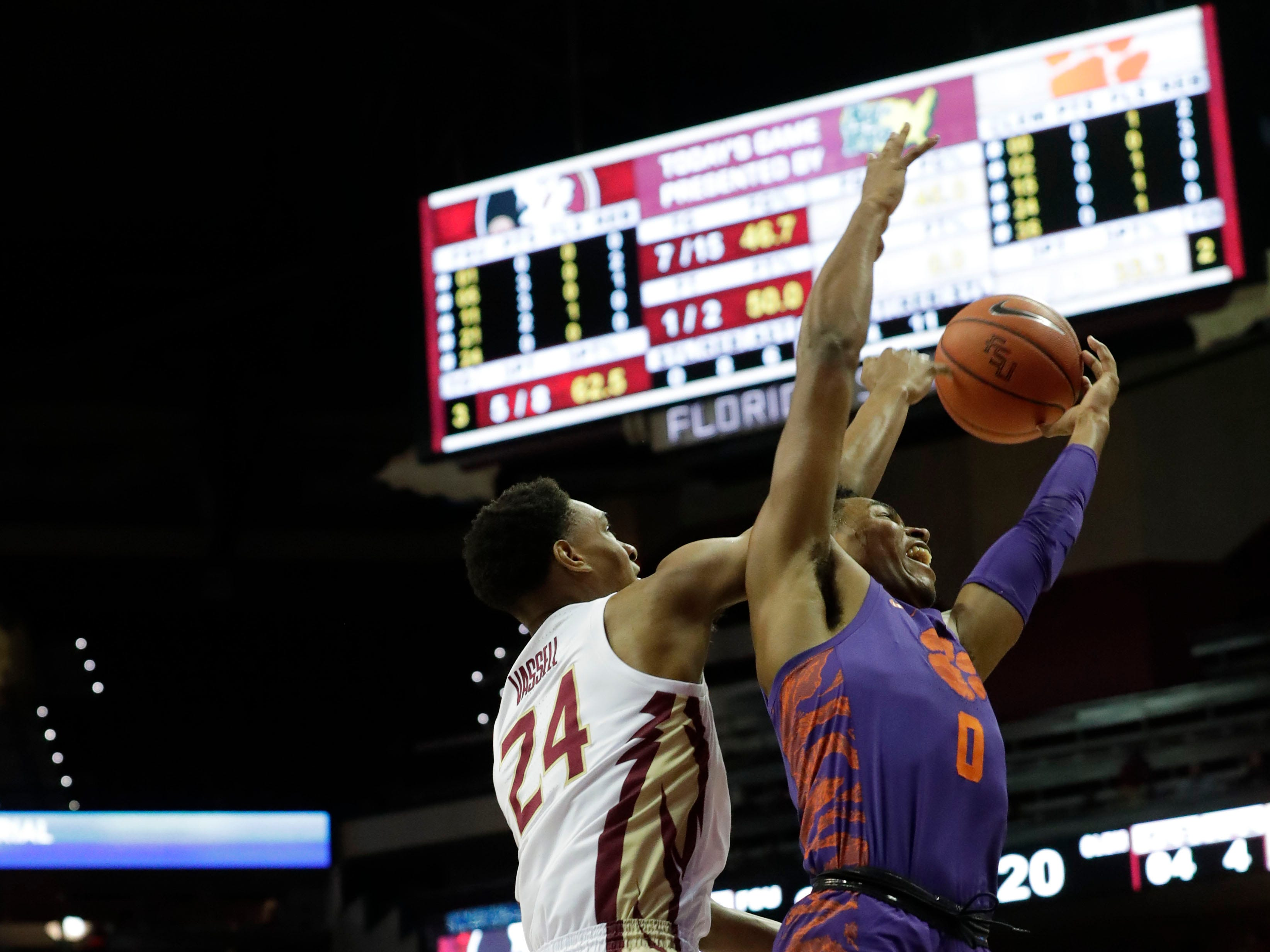 Florida State Seminoles guard Devin Vassell (24) and Clemson Tigers guard Clyde Trapp (0) fight for the rebound. The Florida State Seminoles face off against the Clemson Tigers at the Tucker Civic Center, Tuesday, Jan. 22, 2019.