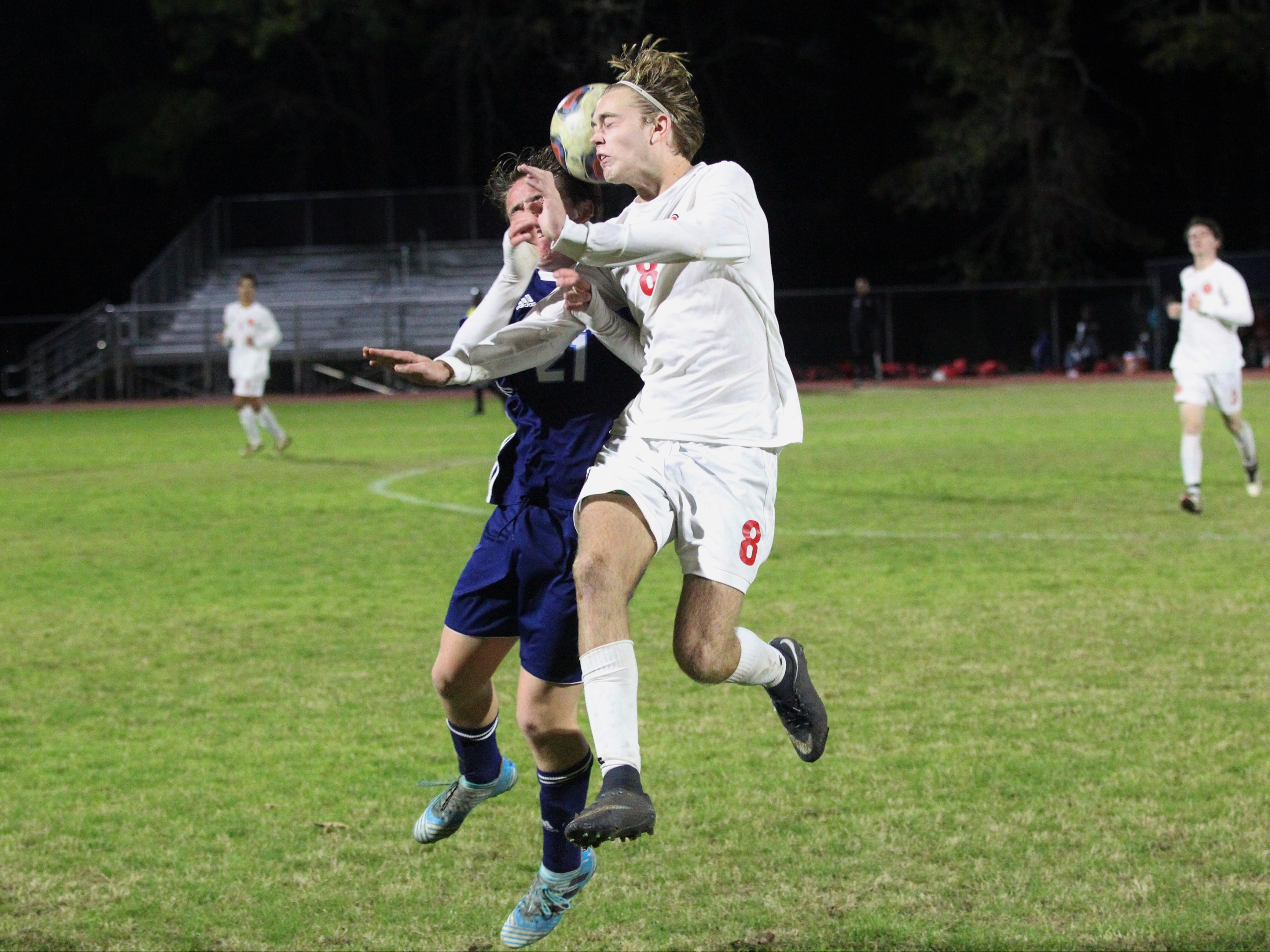 Leon's Nick Ramsden and Maclay's Broedy Poppell collide on a 50/50 ball as Leon's boys soccer team beat Maclay 3-1 on Jan. 22, 2019.