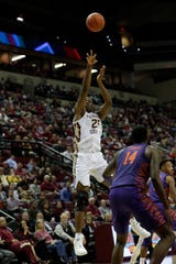 Florida State Seminoles forward Mfiondu Kabengele (25) shoots for three. The Florida State Seminoles face off against the Clemson Tigers at the Tucker Civic Center, Tuesday, Jan. 22, 2019.