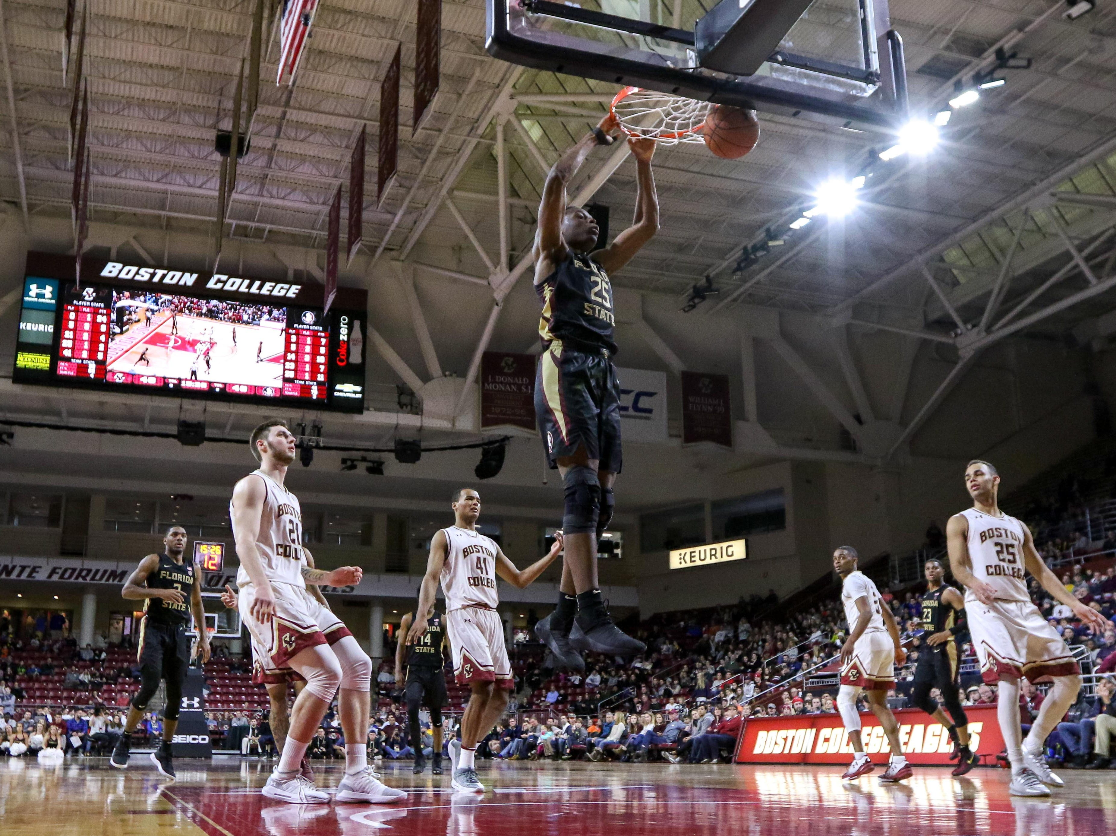 Jan 20, 2019; Chestnut Hill, MA, USA; Florida State Seminoles forward Mfiondu Kabengele (25) dunks the ball against the Boston College Eagles during the second half at Conte Forum. Mandatory Credit: Paul Rutherford-USA TODAY Sports