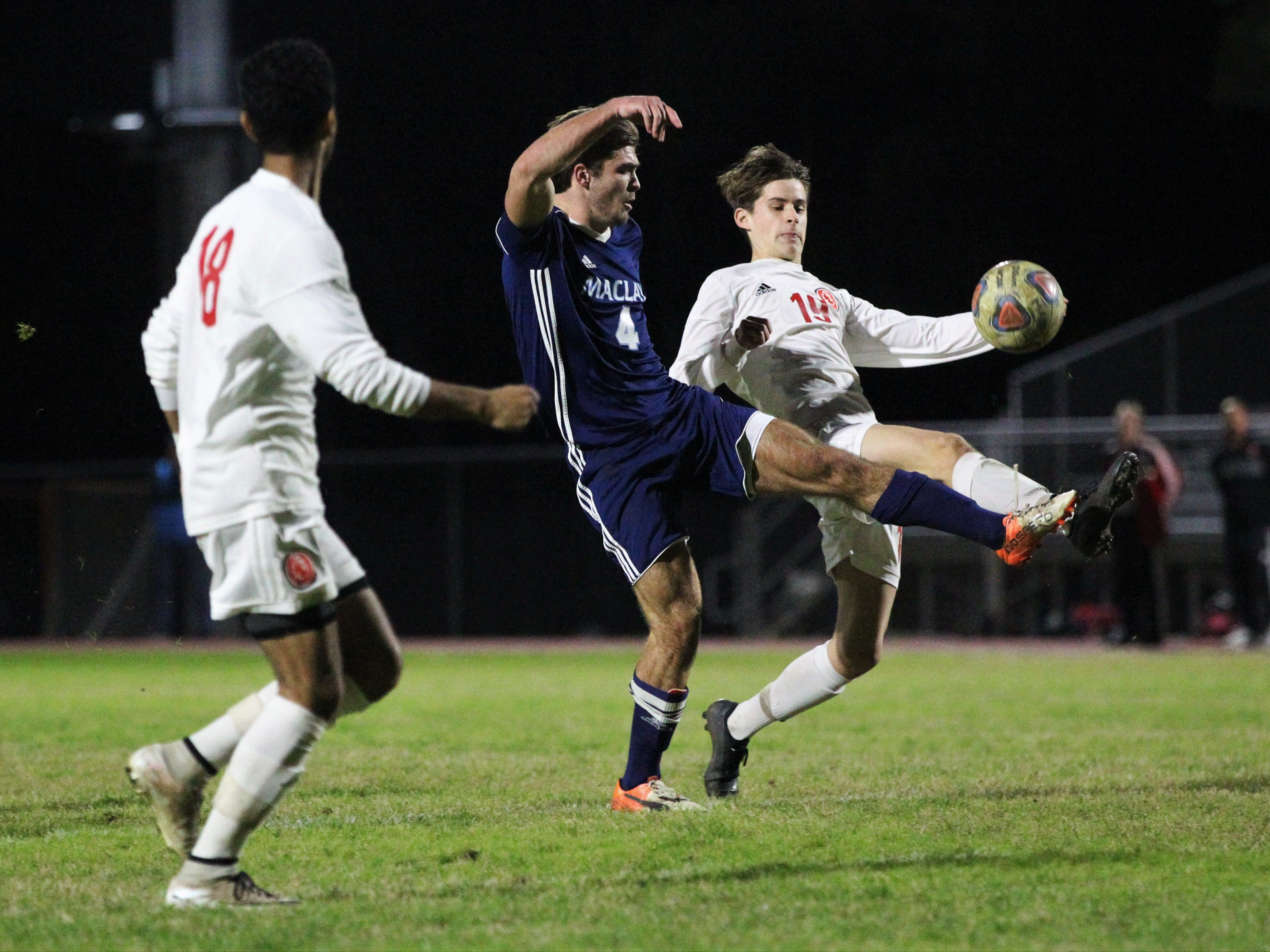 Maclay's Jordan Pichard and Leon's Antonio Nunez try to gain possession as Leon's boys soccer team beat Maclay 3-1 on Jan. 22, 2019.