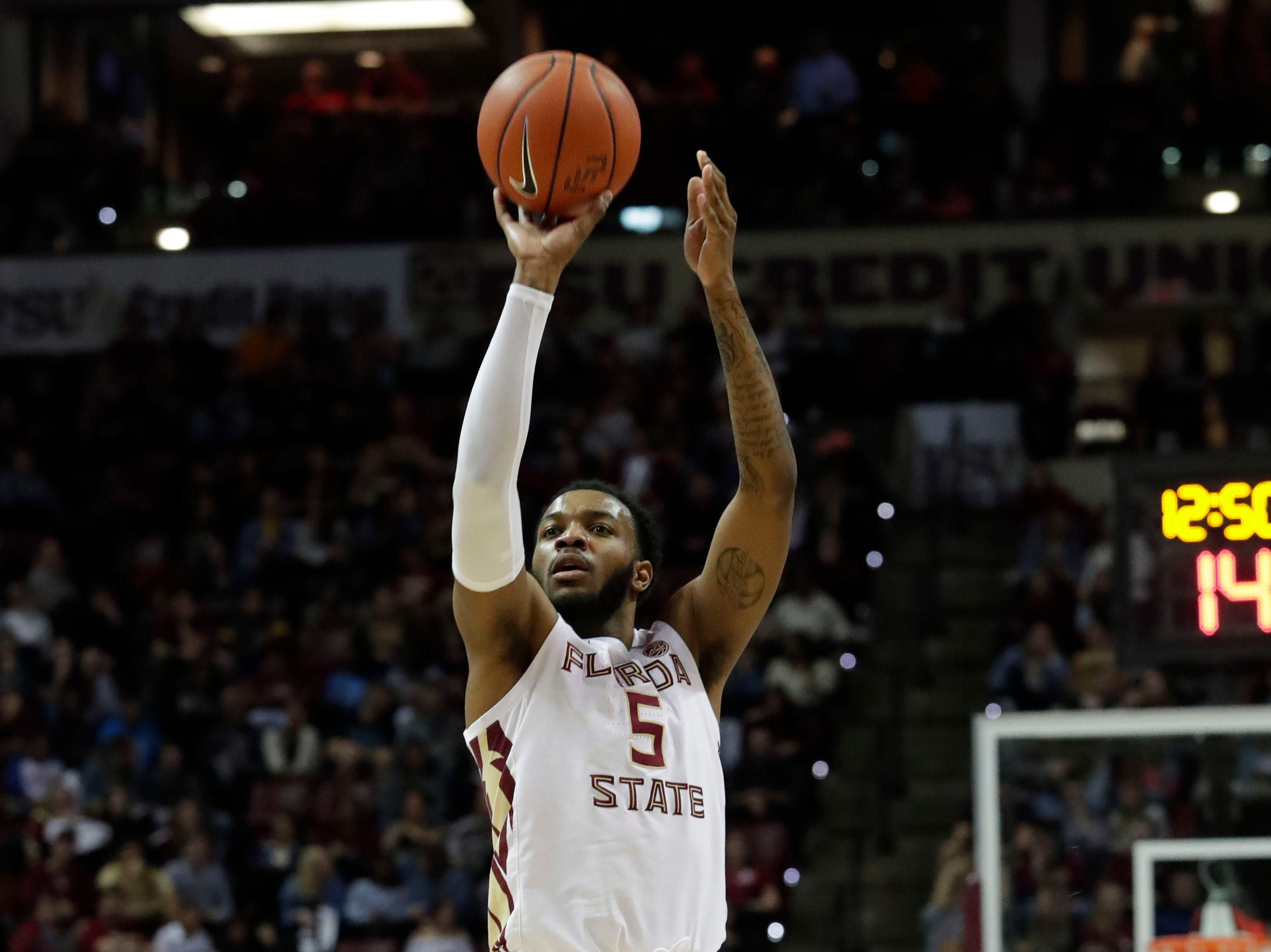 Florida State Seminoles guard PJ Savoy (5) shoots for three. The Florida State Seminoles face off against the Clemson Tigers at the Tucker Civic Center, Tuesday, Jan. 22, 2019.
