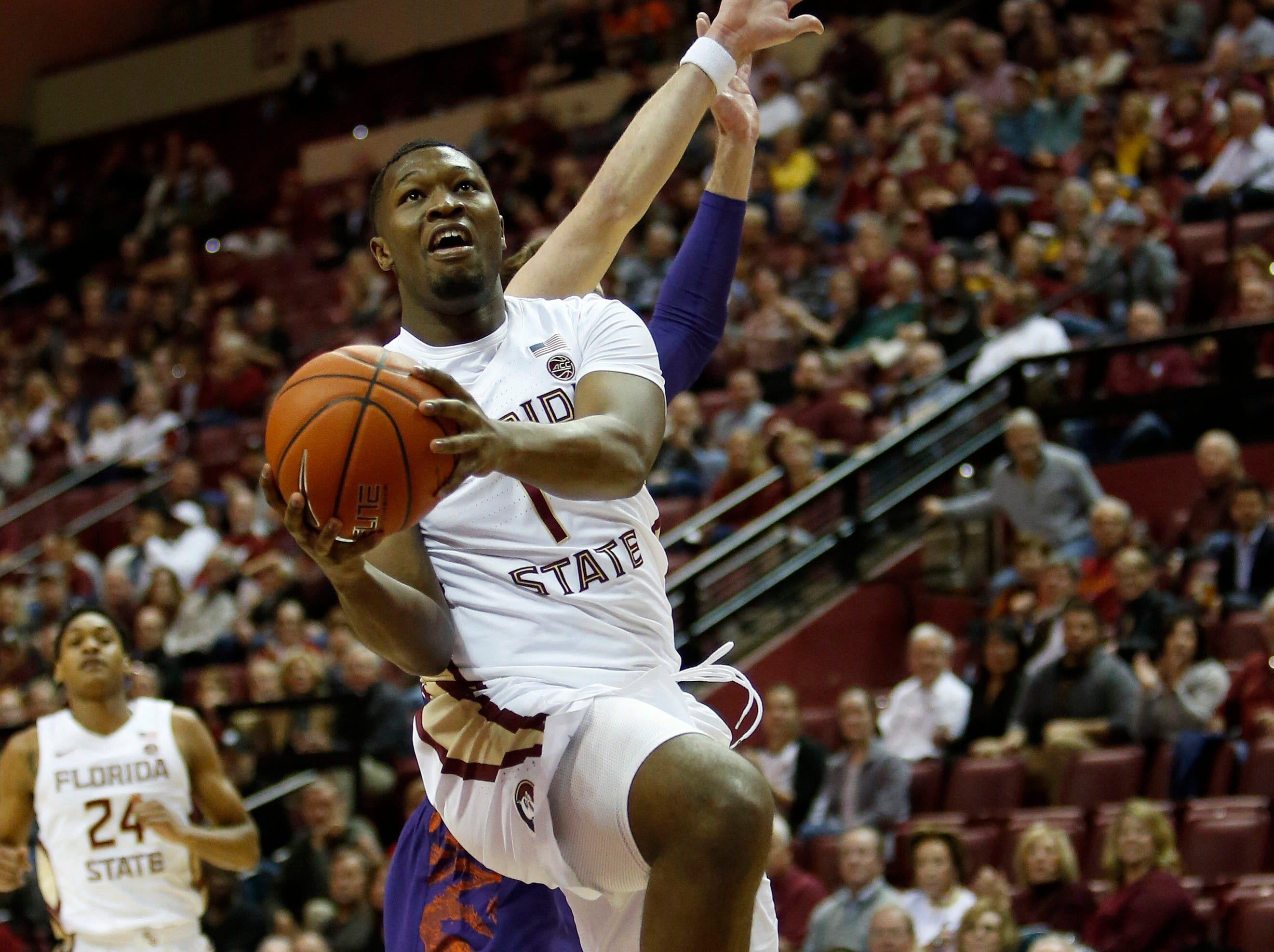 Jan 22, 2019; Tallahassee, FL, USA; Florida State Seminoles forward Raiquan Gray (1) scores on a layup against the Clemson Tigers during the first half at Donald L. Tucker Center. Mandatory Credit: Glenn Beil-USA TODAY Sports