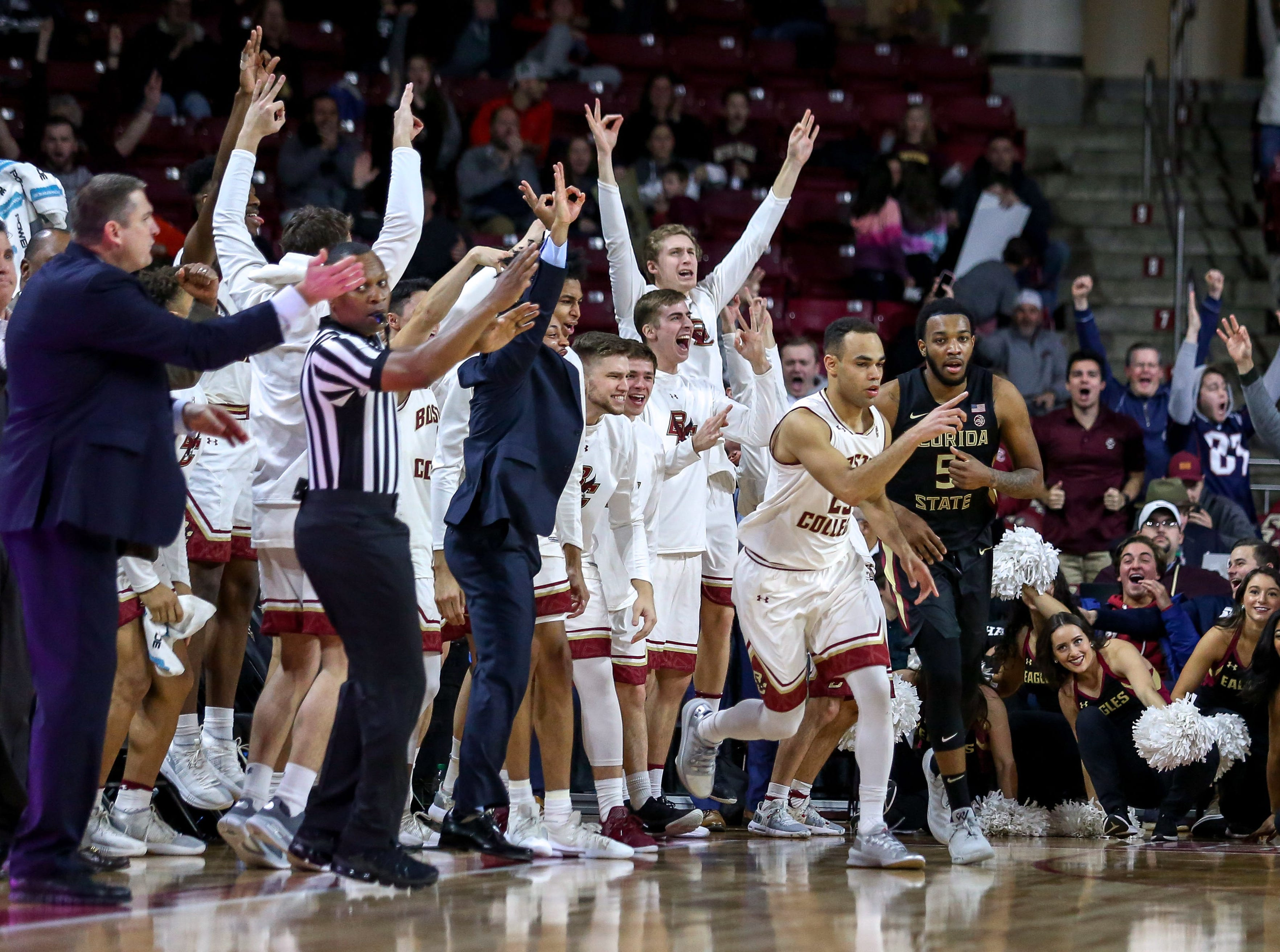 Jan 20, 2019; Chestnut Hill, MA, USA; Boston College Eagles guard Jordan Chatman (25) and the Boston College Eagles bench reacts against the Florida State Seminoles during the second half at Conte Forum. Mandatory Credit: Paul Rutherford-USA TODAY Sports