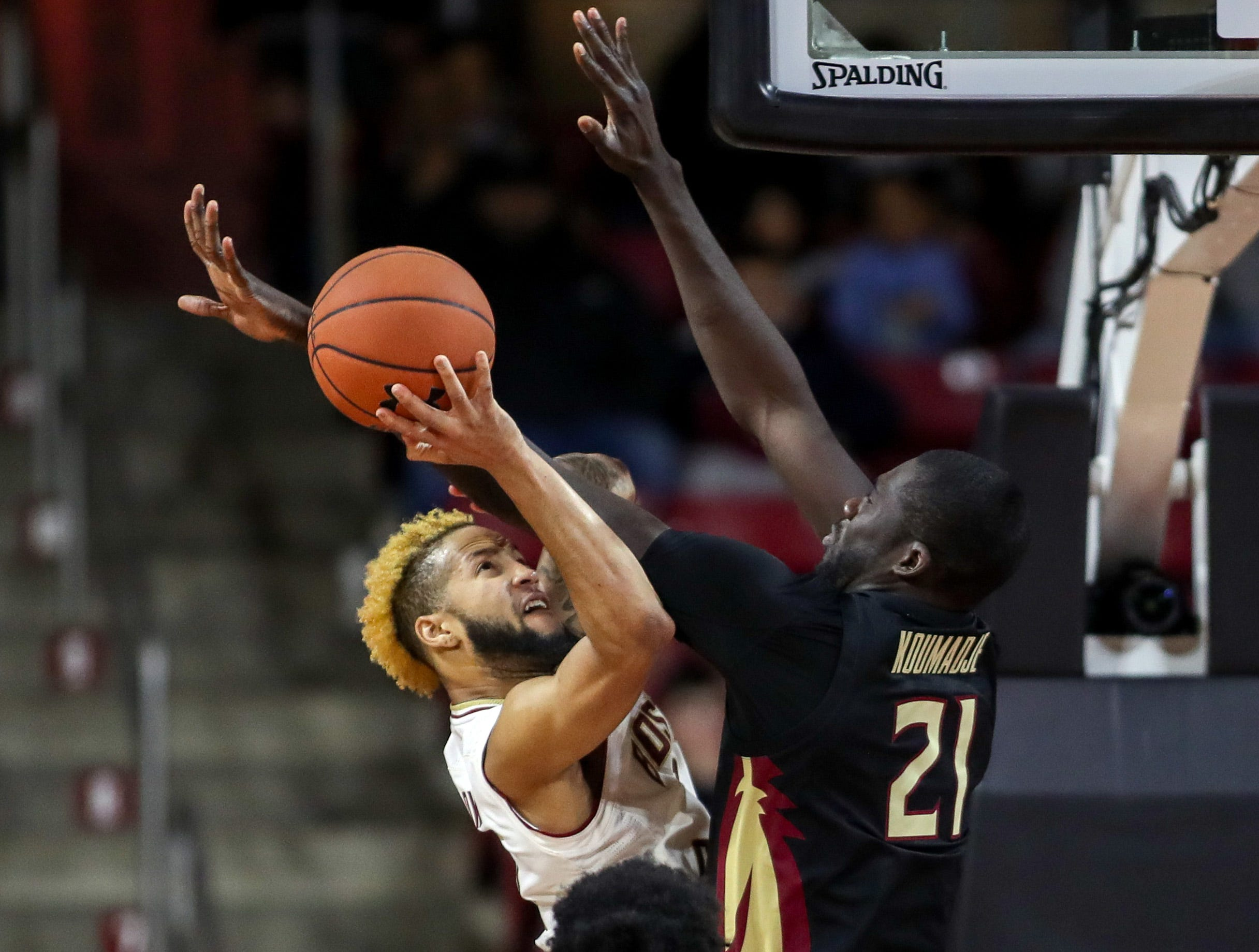 Jan 20, 2019; Chestnut Hill, MA, USA; Boston College Eagles guard Ky Bowman (0) shoots against Florida State Seminoles center Christ Koumadje (21) at Conte Forum. Mandatory Credit: Paul Rutherford-USA TODAY Sports
