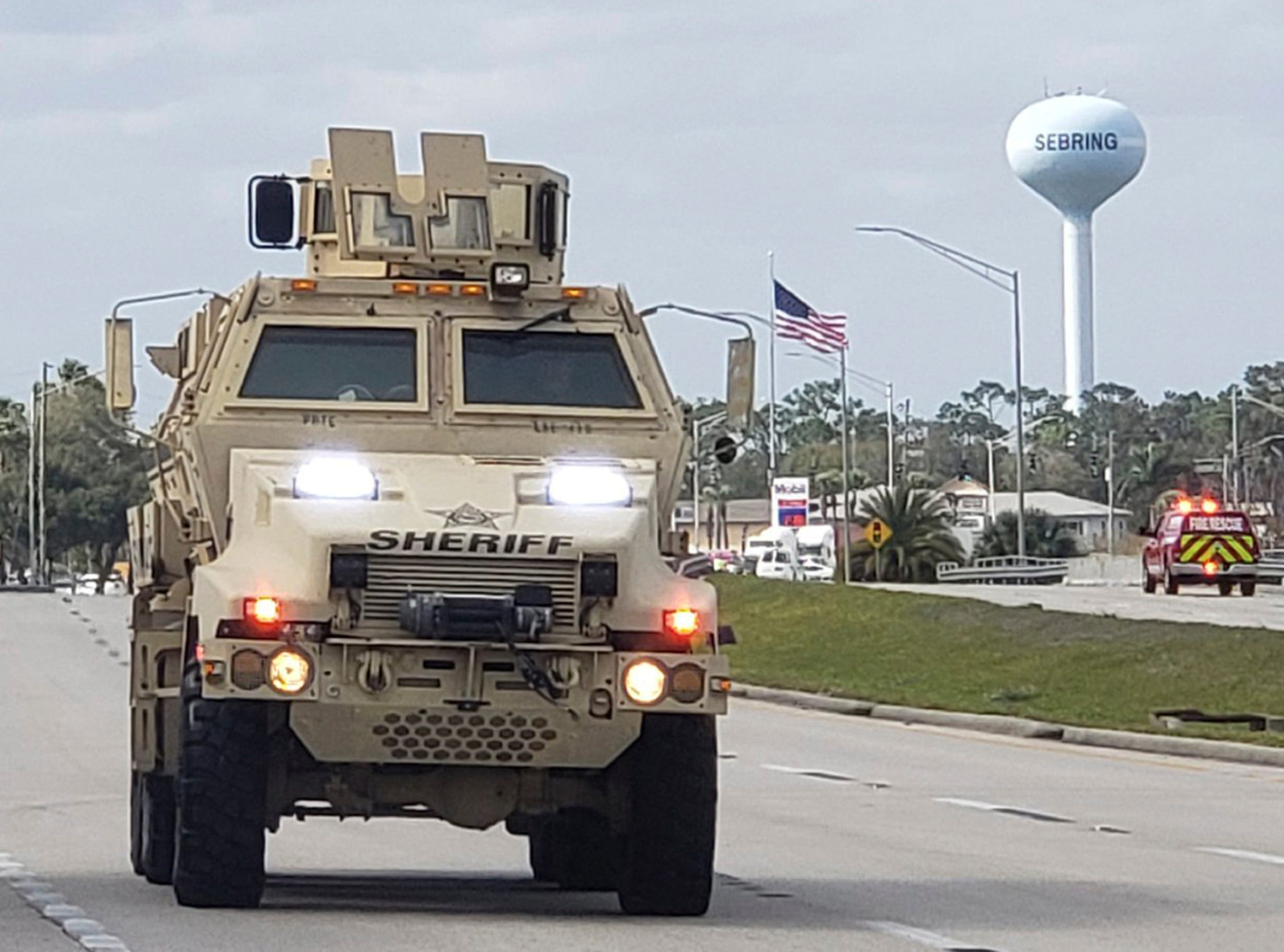 A sheriff's department armored vehicle arrives at a SunTrust Bank branch, Wednesday, Jan. 23, 2019, in Sebring, Fla. Authorities say they've arrested a man who fired shots inside the Florida bank.