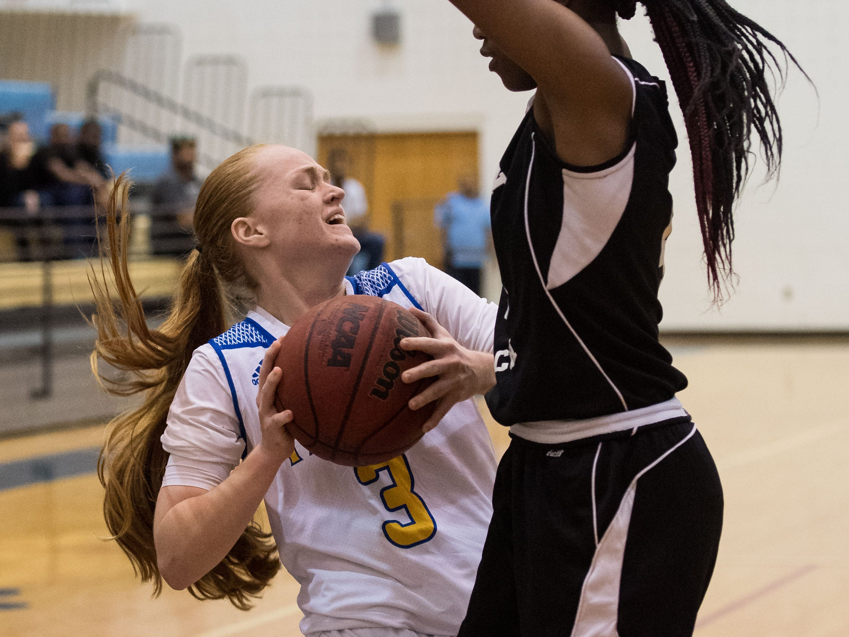 Martin County's Elise Liggett (left) comes up against a wall as Jensen Beach's Jakiya Taylor defends and eventually blocks the shot during the third period of the high school girls basketball game Tuesday, Jan. 22, 2019, at Martin County High School in Stuart.
