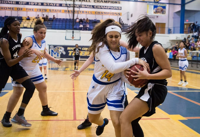 Martin County's Hana Mabrouk (center) tries to keep the ball away from Jensen Beach's Danica Osdon, leading to a Jensen possession, during the fourth period of the high school girls basketball game Tuesday, Jan. 22, 2019, at Martin County High School in Stuart.
