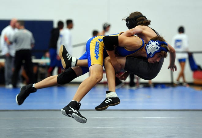 Martin County High School's Jesse Espinosa takes Treasure Coast's Albert Allcroft off his feet and to the mat on Wednesday, Jan. 23, 2019 during a wrestling match at the Centennial Dual Invitational at St. Lucie West Centennial High School in Port St. Lucie. Other schools participating were Centennial, Heritage, Okeechobee and Orlando Jones high schools.