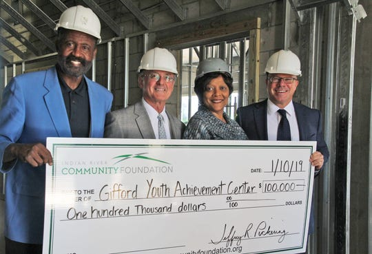 Gifford Youth Achievement Center's Public Relations and Facilities Operations Director Freddie Woolfork, left, with Scott Alexander, representing the Indian River Community Foundation and GYAC as a board member; Jeff Pickering, president and CEO of the Community Foundation; and Angelia Perry, executive director of GYAC.