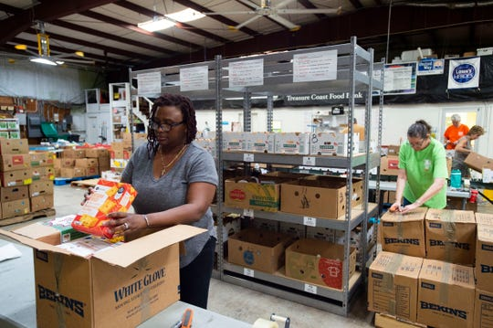 "Furloughed Department of Interior employee Jennifer Gilchrist (left), of Fort Pierce, helps sort and pack food boxes for federal employees Wednesday, Jan. 23, 2019, at the Treasure Coast Food Bank in Fort Pierce. The food bank reached out to different federal offices in the Treasure Coast area, including U.S. Customs and Border Protection, the Internal Revenue Service and the Social Security Administration, to offer assistance to employees who have been out of work. ""I was affected by the furlough, so I decided to volunteer my time in between applying for jobs,"" Gilchrist said, who hasn't been able to work since Dec. 23, 2018."