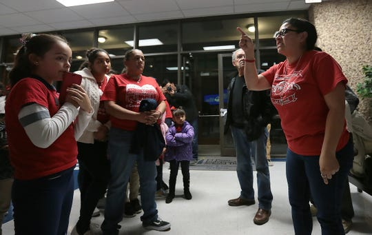 Hilda Villegas, a Beall Elementary School mom and a member of Familias Unidas del Chamizal, tells fellow parents and teachers that their fight to keep their school open is not over.
