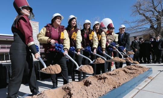 Andress High School student council, band members and Principal Joseph Manago  participate in a ceremonial groundbreaking at the school Wednesday. Andress will receive $32 million in upgrades including a 500-seat performing arts center with fine arts classrooms, new athletic fields, a field house, landscaping improvements, air conditioning upgrades and a new student quad. The renovations are funded by the 2016 EPISD Bond.