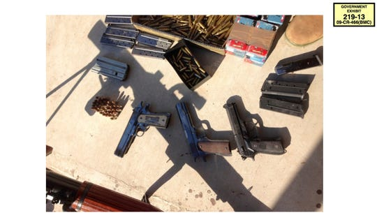 """In this undated photo provided by the U.S. Attorney's Office for the Eastern District of New York, a cache of weapons and ammunition seized by authorities from the Sinaloa cartel is shown. The first handgun on the left bears the initials of Mexican drug lord Joaquin """"El Chapo"""" Guzman. The photo was offered as evidence in Guzman's drug trafficking trial in New York on Thursday, Jan. 17, 2019."""