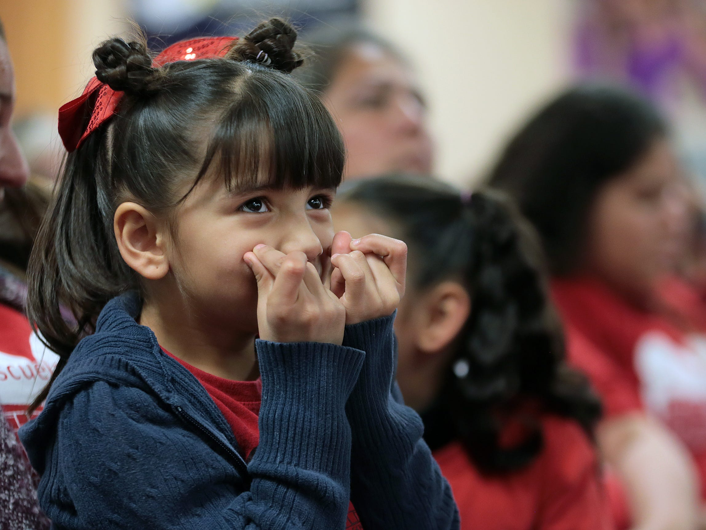 Beall Elementary School kindergarten student Keyreth Arias, 5, crosses her fingers as EPISD board members prepare to vote on closing her school Tuesday. The board voted to close Beall, Burleson, Alta Vista and Schuster.