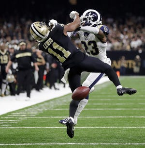 Rams defensive back Nickell Robey-Coleman (23) drills Saints wide receiver Tommylee Lewis during a third-down pass near the end of Sunday's NFC Championship Game. A referee who has local ties has come under fire for not calling pass interference on the play.