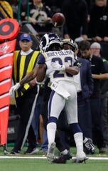 Rams defensive back Nickell Robey-Coleman (23) hits Saints wide receiver Tommylee Lewis while the ball is in air near the end of Sunday's NFC Championship Game. The Saints and their fans were furious there was no pass interference called on the play.