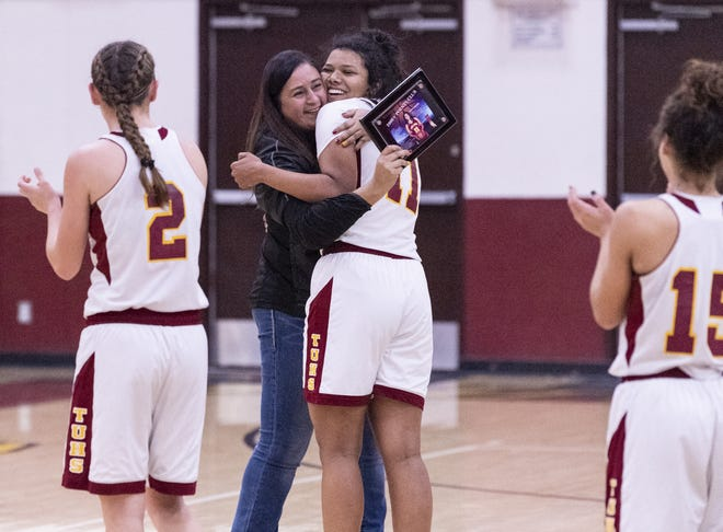 Tulare Union girls basketball coach Monica Diaz congratulates Kiara Brown after the basket that put Brown over 2,000 career points in a girls basketball game against Monache on Tuesday, January 22, 2019.