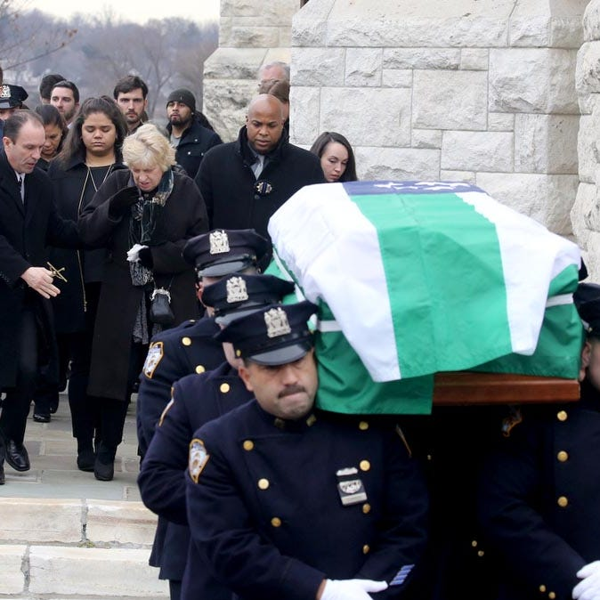 Mourners attend NYPD officer Brian Kessler 's funeral