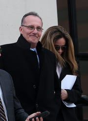 Former Harrison police chief Anthony Marraccini leaves U.S. District Court in White Plains with his wife Tabatha after he pleaded guilty to tax evasion Jan. 23, 2019.