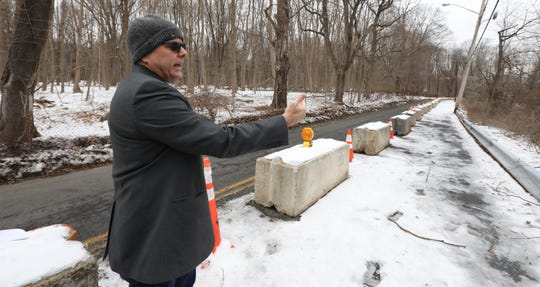 Suffern Mayor Ed Markunas on Memorial Dr. Jan. 23, 2019. The eastbound lane of the road is closed because of erosion on the banks of the adjacent Mahwah River.