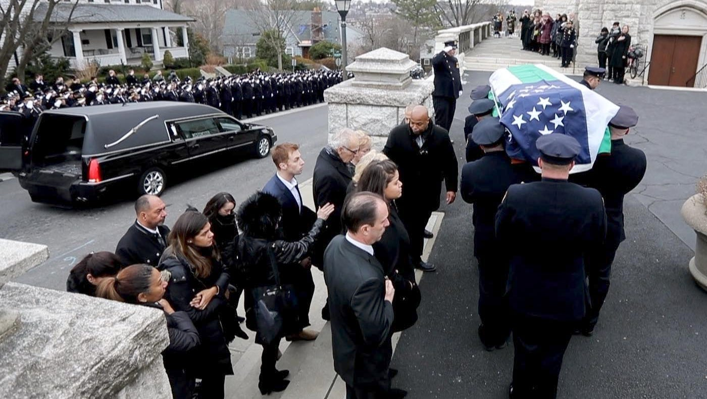 The casket of NYPD officer Brian Kessler is...