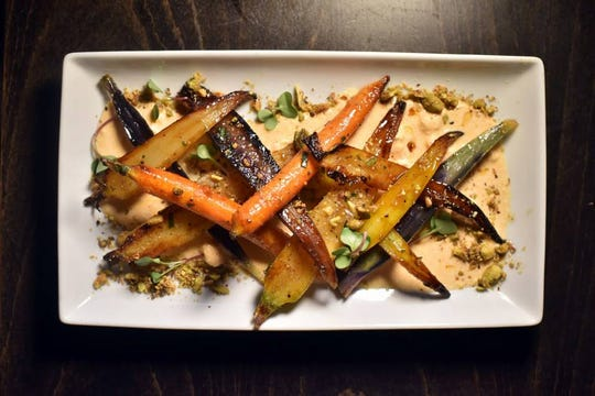 Roasted rainbow carrots with whipped feta, local honey and pistachios are on the menu at Communal Kitchen in Nyack.