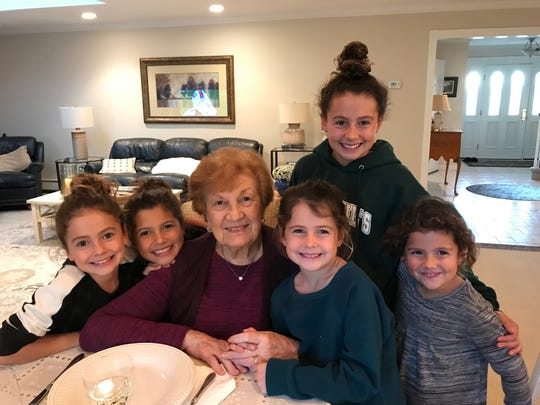 Vera Leteria and her great-granddaughters.