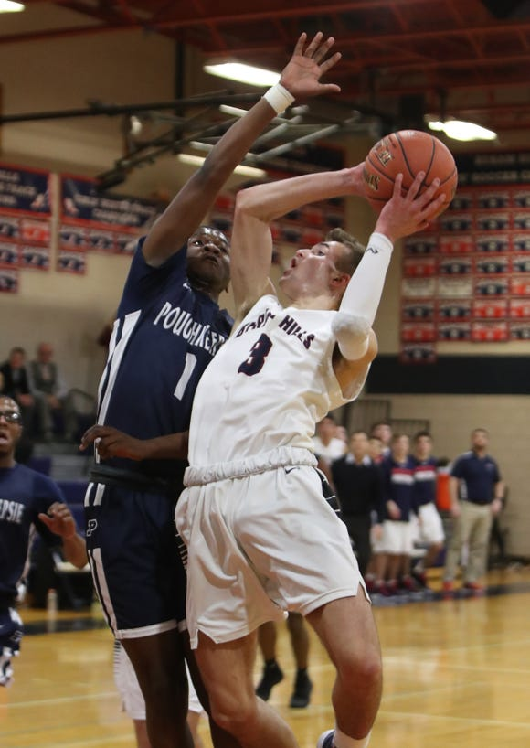 Byram Hills' Willy Samsen is pressured by Poughkeepsie's Jamik Carter during their game at Byram Hills Jan. 22, 2019. Poughkeepsie won 63-62.