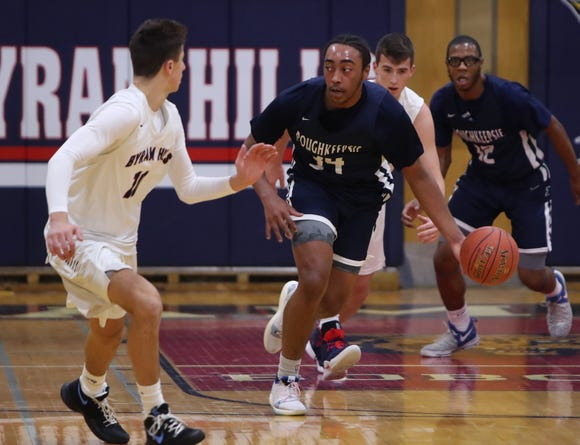 Byram Hills' Jon Trongone guards Poughkeepsie's Davontrey Thomas during their game at Byram Hills Jan. 22, 2019. Poughkeepsie won 63-62. 10 34