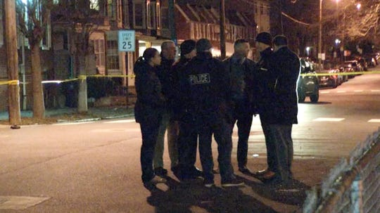Wilmington Police investigate the scene of a shooting Tuesday night on Pine Street.