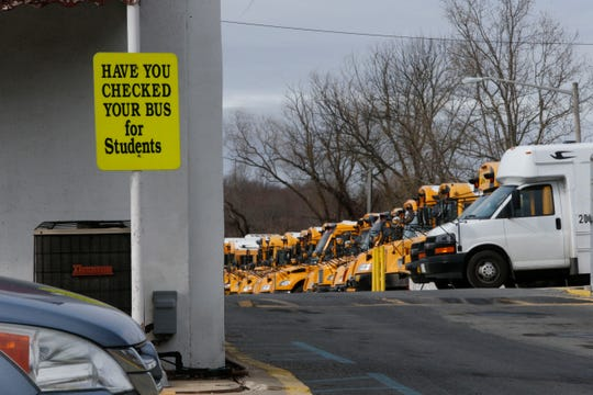 Red Clay Consolidated School District buses sit in a bus yard in New Castle.