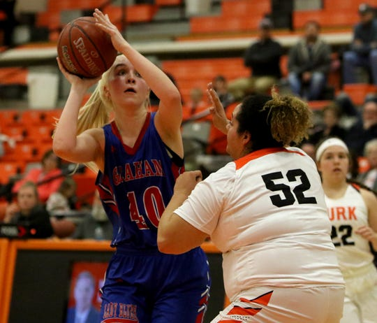 Graham's Cammi Teplicek looks to the basket by Burkburnett's Kerissa Durham Tuesday, Jan. 22, 2019, in Burkburnett. The Lady Blues defeated the Lady Bulldogs 55-47.