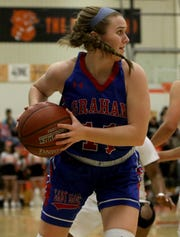 In addition to track, Claire Jones also plays on Graham's basketball team.