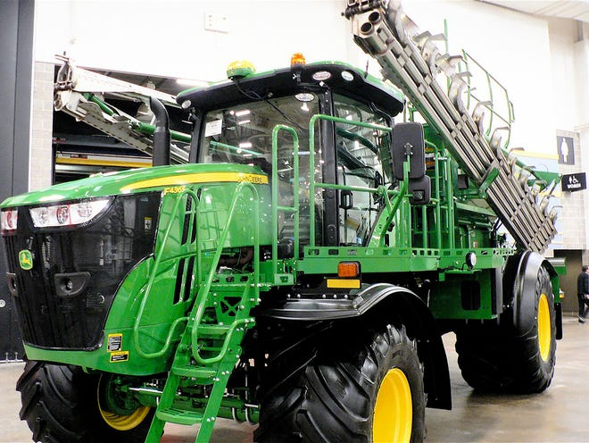 A John Deere fertilizer applicator can cover many acres in a day's time.