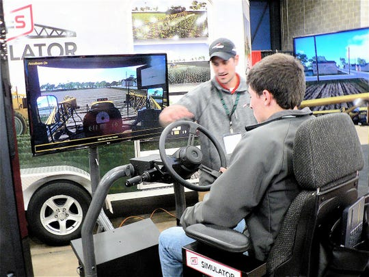 Visitors practiced driving a huge sprayer on the road and in the field at the Insight FS exhibit.