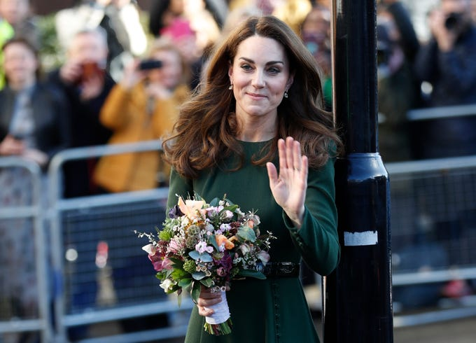 Britain's Kate, Duchess of Cambridge waves to a crowd of well-wishers after a visiting to the 'Family Action' charity in south in London, Tuesday, Jan. 22, 2019, where she helped launch a new national support line.  Family Action works directly with vulnerable children and families, with their new 'FamilyLine' service using new technology for remote contact to support parents and carers.  (AP Photo/Alastair Grant) ORG XMIT: XAG102