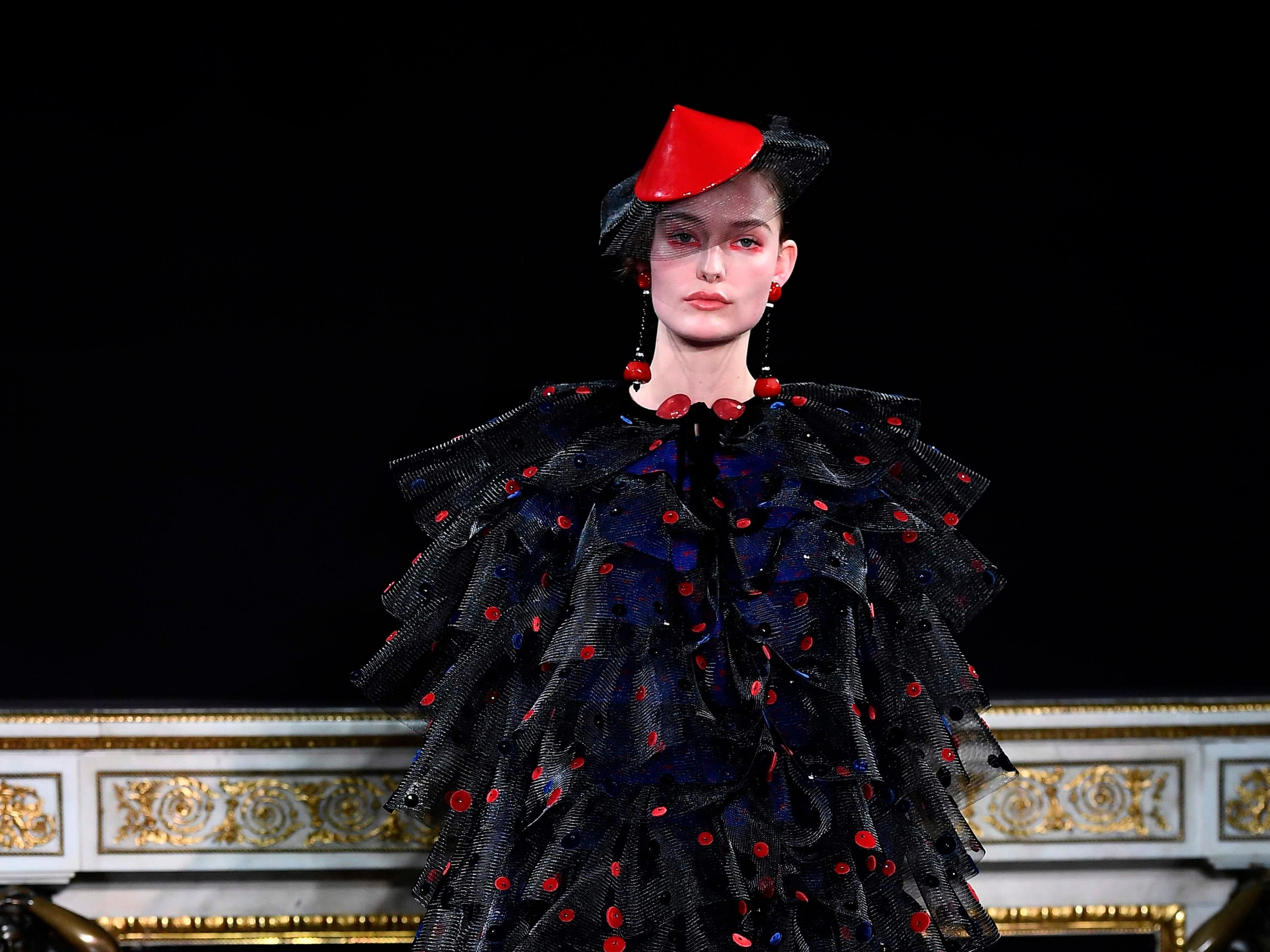 A model presents a creation by Giorgio Armani during the 2019 Spring-Summer Haute Couture collection fashion show in Paris, on January 22, 2019. (Photo by Anne-Christine POUJOULAT / AFP)ANNE-CHRISTINE POUJOULAT/AFP/Getty Images ORIG FILE ID: AFP_1CI5AF