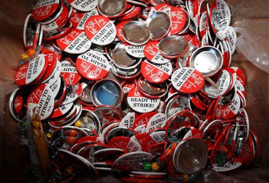 In this Jan. 17, 2019, file photograph, buttons for a teachers' strike sit in a box in the union's headquarters in south Denver.