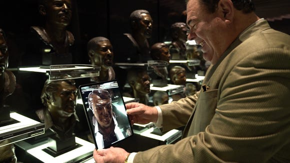 You will be able to interact with John Madden's bronze bust at the Pro Football Hall of Fame.
