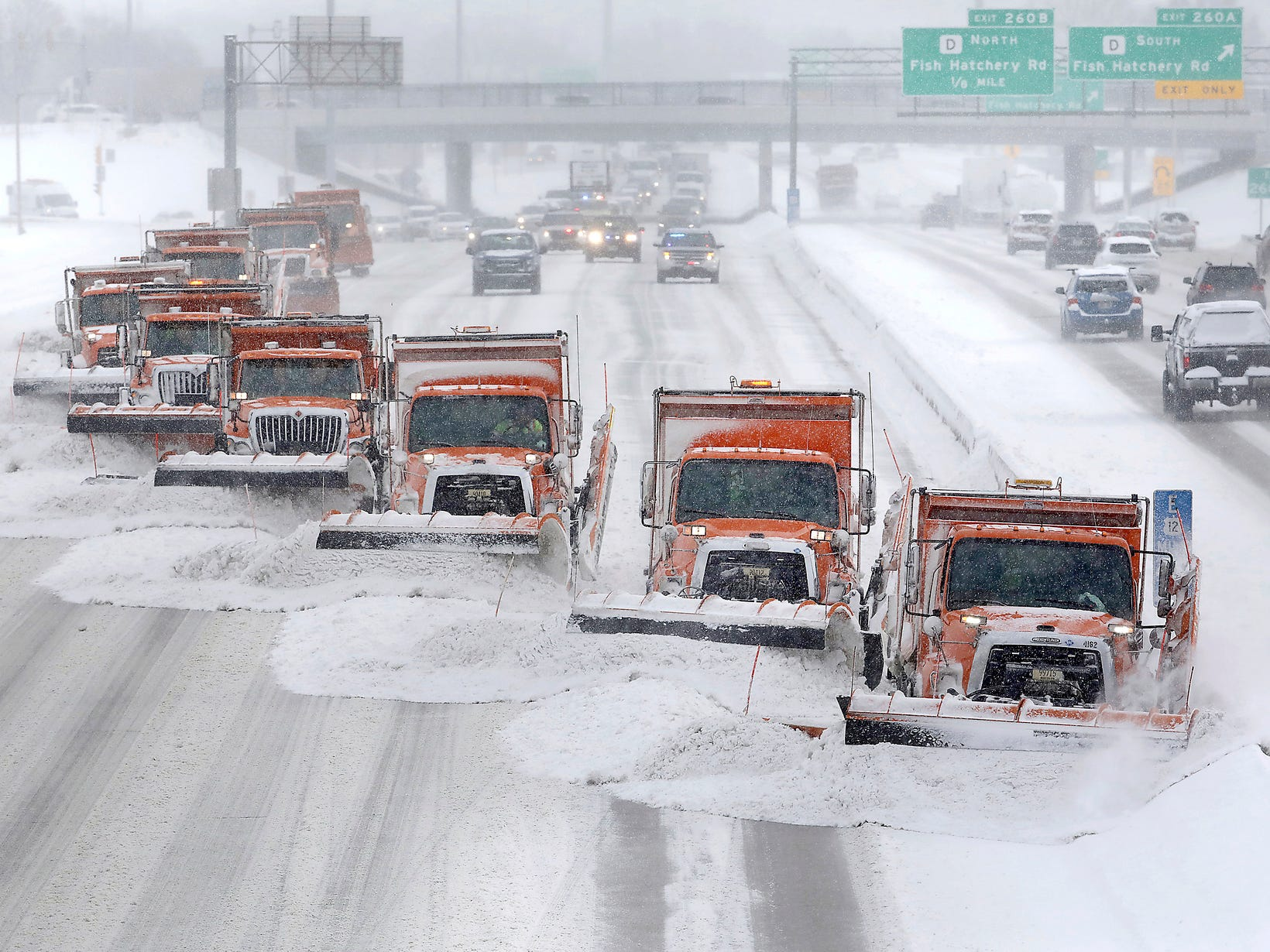 As a winter storm system moves through the upper Midwest, a plowing operation involving Dane County, Wis. snow plows clears snow from the westbound lanes of U.S. Highway 12/18 in Madison, Wis., Jan. 23, 2019.